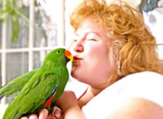 Women kissing a parrot